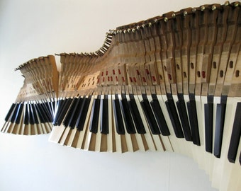 Sound Wave, an upcycled piano wall sculpture