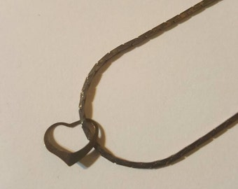 Heart charm on silver necklace