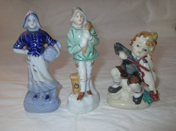 3 MIOJ Figurines Made in Occupied Japan: Dutch Woman, Fisherman, Boy with Violin (c. 1945-52)