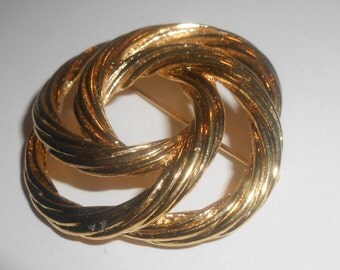 Vintage MONET Gold Tone Textured Open work Swirling Loops Brooch