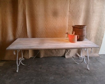 Dining Table custom made from reclaimed wood and wrought Iron