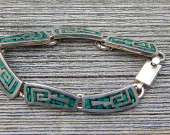 Mexican or Zuni 925 Silver Bracelet with turquoise inlay. With clip closure
