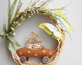 Spring bunnies wreath, Easter wreath with bunnies in a carrot car, butterfly and green grasses, green- orange- yellow, Easter wreath