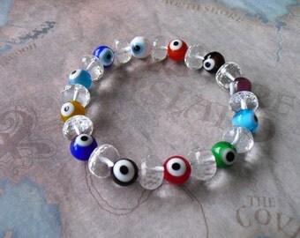 Crystal clear quartz & evil eye bracelet