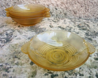 Four French amber glass dessert/ sweet bowls/dishes