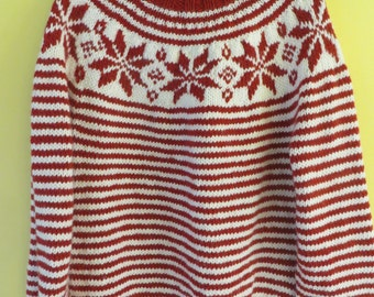 Red and white striped sweater with snowflake motif