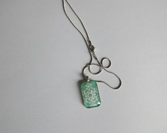 Green glittery snowflake necklace