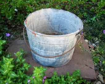 Shabby large galvanized pail-metal bucket -large pail -farm pail -vintage -feed bucket- rustic primitive- swinging handle- porch planter