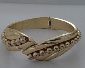 vintage yellow metal hinged bangle