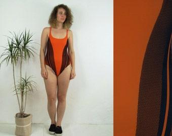 90's vintage women's one piece orange swimsuit/swimwear