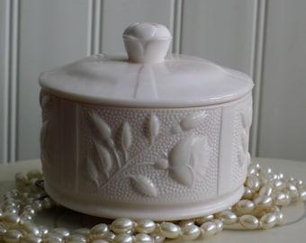 Pink milk glass lidded powder jar: Jeannette
