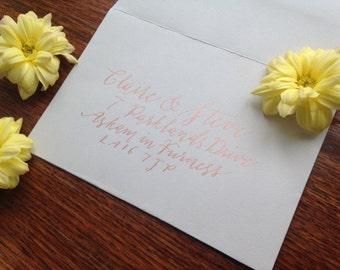 Calligraphy envelope addressing in copper ink