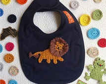 baby bib in blue cotton personalised with hand embroidered lion