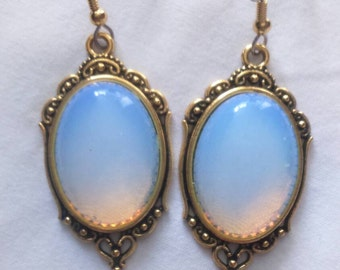 Neo-baroque earrings cabochon Opal, fasteners made of surgical steel.