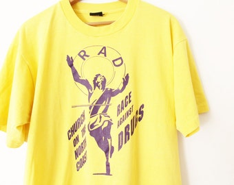 XLARGE Vintage 1990s RAD Race Against Drugs Church on the North Coast Graphic T-Shirt
