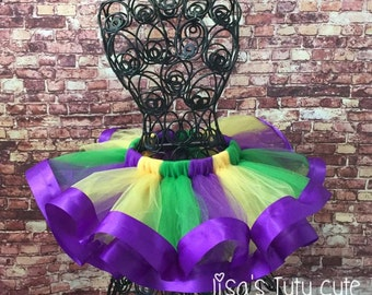 Mardi gras tutu. Ribbon tutu. Green, purple, and yellow tutu. Parade tutu. Purple ribbon tutu. Jester tutu.