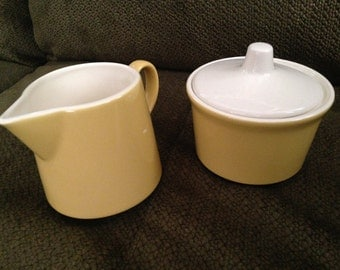 Set of Yellow and Ivory Cream Pitcher and Sugar Bowl
