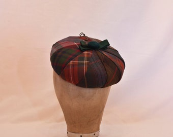 Handmade round pleated tartan hat decorated with velvet bow, button and kilt pin