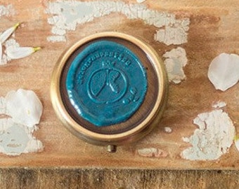 SOLID PERFUME completely natural with coconut oil to nourish the skin.