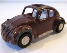 Vintage Tonka Toys Volkswagen Beetle, chippy paint, missing bumpers, well played with