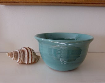 Small turquoise bowl.