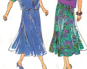 "Kwik Sew 1980, Sz 8-22/XS-XL/Bust 31.5-45"". Vintage 90s Kwik Sew Loose Fit Pullover Asymetric Hem Dolman Sleeve Top & 8 Gore Skirt pattern"