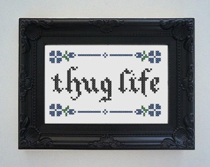 Framed 'Thug life' cross stitch