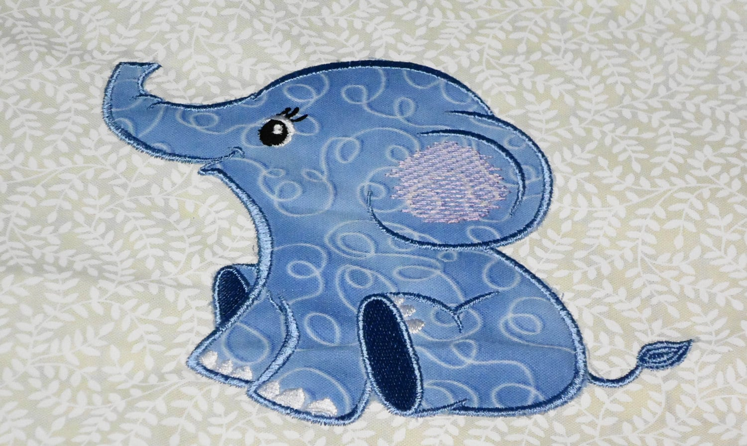 Baby elephant appliqué and filled embroidery design for