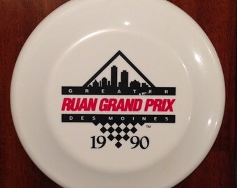 Vintage 1990 Greater Des Moines Ruan Grand Prix Souvenir Enduro Flying Toy Frisbee. Terrific red and black graphics. Measures approximately