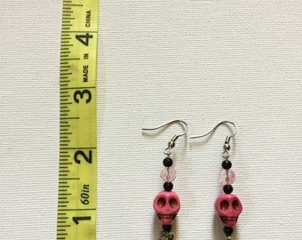 Silver Toned Earrings with Pink Skulls