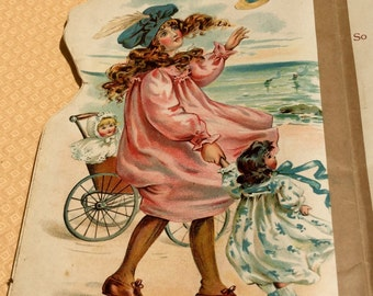 Antique Dolly at the Seaside ABC book, printed in 1909 with charming illustrations.