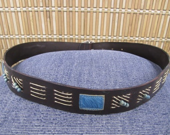 Dark chocolate brown leather belt with beading and fur