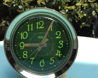 Vintage Tozaj clock, wind up 80s glow in the dark clock. Lime green numbers.