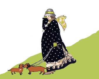 DACHSUND LADY..a lady and her two dogs out for a blowy walk on a hillside. Lovely gentle printed  card from a collage original