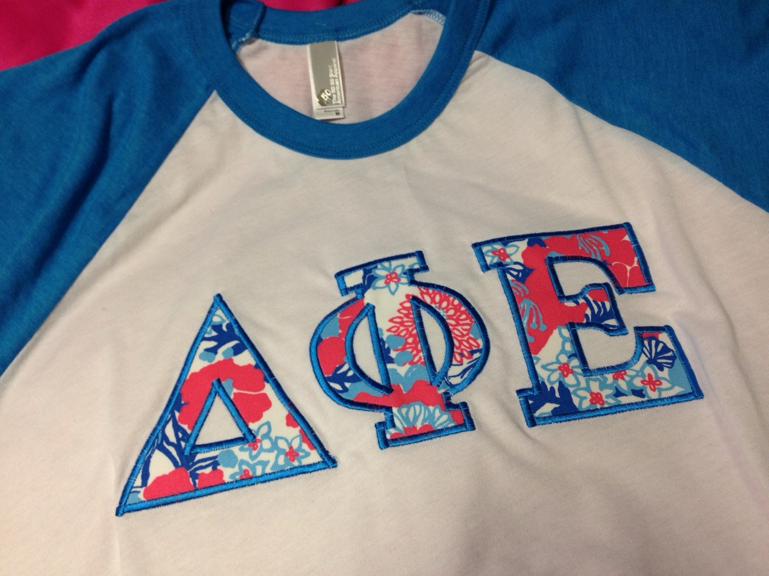 Delta Phi Epsilon Lilly Baseball T Shirt In Size Extra Small