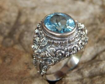 Rangda motifs carved silver ring blue topaz stone