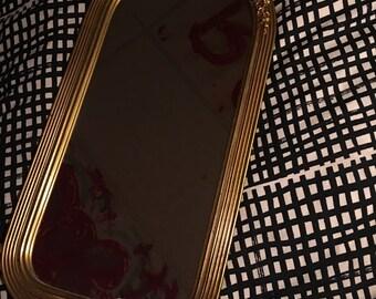 Golden bow mirror