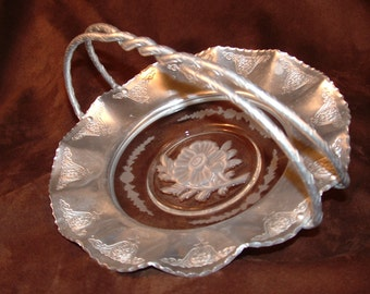 Vintage hammered aluminum serving basket with etched glass center is wonderful to use or display.  Is it a Wedding Basket?