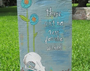 ain't no rest for the wicked, Cage the Elephant lyrics, lyrics art painting on salvaged wood, music lyrics, cloudy day, sun, outsider art