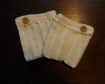 Boot cuffs are hand crocheted with Loops & Threads yarn. They are embellished with buttons.