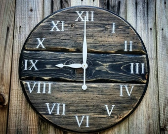 Rustic Clock: 24in diameter, ebony blend with ivory numbers and clock arms.