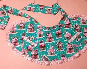 Gingerbread House apron with pockets and pink satin ruffle
