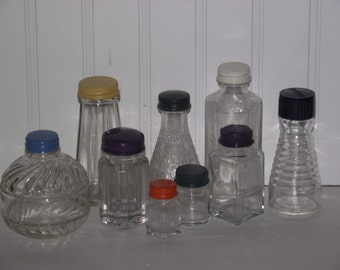 Nine vintage bottles (1950's-1960's) from various products with colorfully painted metal caps, all in very good condition.
