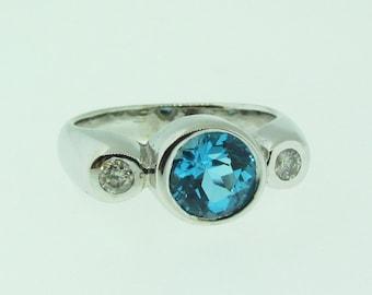 Hand made custom design 14 K white gold Blue Topaz diamond ring.
