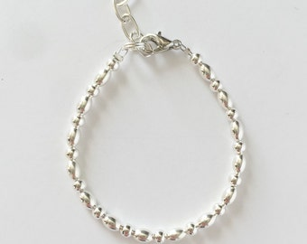 Oblong and round silver beaded Baby Bracelet