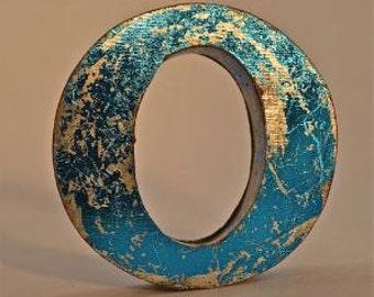A fantastic vintage style metal 3D blue letter O