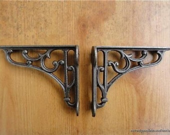 A pair of small classic Victorian scroll help brackets  4 inch bracket cast iron