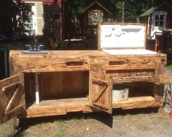 Custom Handcrafted Outdoor Sink And Cooler Made From Reclaimed Wood For Outdoor Entertainment Area.
