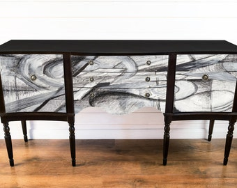 Black sideboard with abstract design