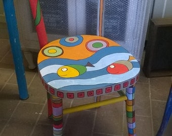 Chair hand decorated with geometric patterns and fish